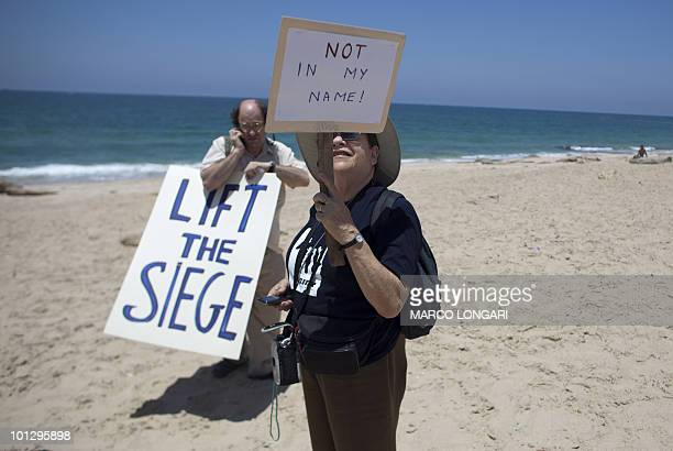 Foreign peace activists and leftwing Israelis protest at the entrance of the southern Israeli port of Ashdod on May 31 2010 against Israel's deadly...