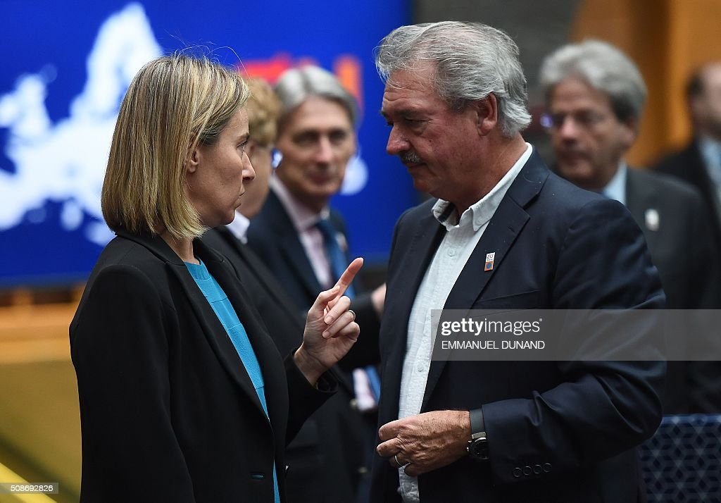 EU foreign policy chief Federica Mogherini (L) and Luxembourg's Foreign Minister Jean Asselborn speak together ahead of a EU foreign ministers meeting in Amsterdam, on February 6, 2016. The European Union on Wednesday finally reached agreement on how to finance a three-billion-euro ($3.3-billion) deal to aid Syrian refugees in Turkey, in exchange for Ankara's help in stemming the flow of migrants. / AFP / EMMANUEL DUNAND