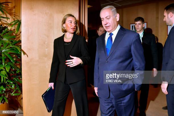 EU foreign policy chief Federica Mogherini speaks with Israeli Prime Minister Benjamin Netanyahu upon his arrival for their meeting at the European...