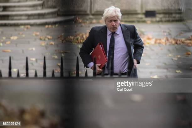 Foreign Secretary Boris Johnson arrives to attend a cabinet meeting in Downing Street on October 17 2017 in London England The Prime Minister is...