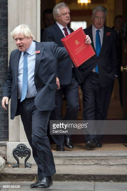 Foreign Secretary Boris Johnson Defence secretary Michael Fallon and Brexit Secretary David Davis leave after attending a cabinet meeting in Downing...