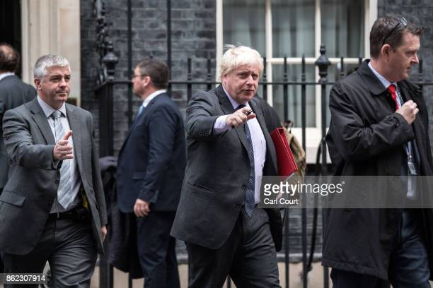 Foreign Secretary Boris Johnson leaves after attending a cabinet meeting in Downing Street on October 17 2017 in London England The Prime Minister is...