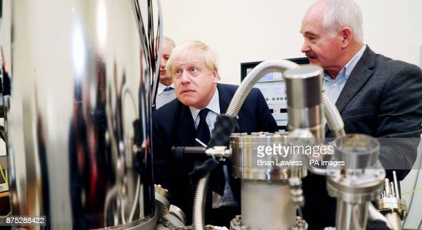 Foreign Secretary Boris Johnson looks at a scanning tunneling microscope with Professor John Boland at Trinity College Dublin