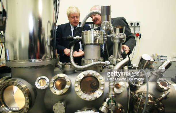 Foreign Secretary Boris Johnson looks at a scanning tunneling microscope with Professor John Boland at the Science Gallery Trinity College Dublin