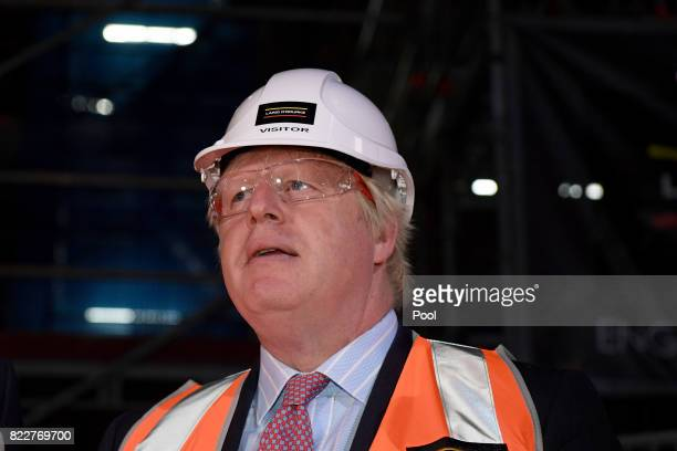 Foreign Secretary Boris Johnson looks on as he tours construction work underway in the Joan Sutherland Theatre at the Sydney Opera House in Sydney...