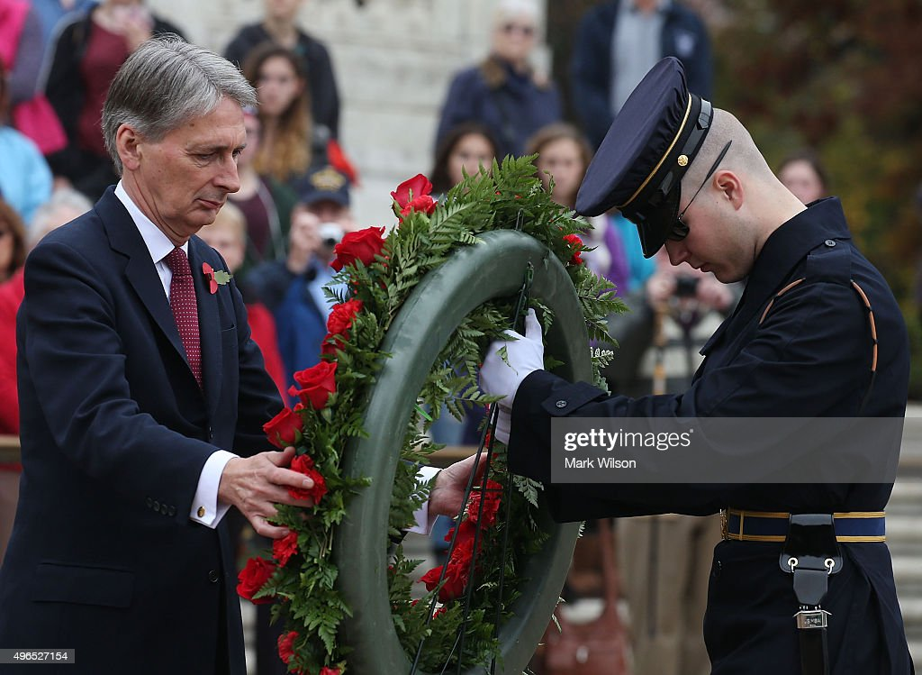 Foreign Secretary <a gi-track='captionPersonalityLinkClicked' href=/galleries/search?phrase=Philip+Hammond&family=editorial&specificpeople=2486715 ng-click='$event.stopPropagation()'>Philip Hammond</a> (L) participates in a wreath-laying at Tomb of the Unknown Soldier in Arlington Cemetery, November 10, 2015 in Arlington, Virginia. Hammond has been in Washington meeting with US officials.