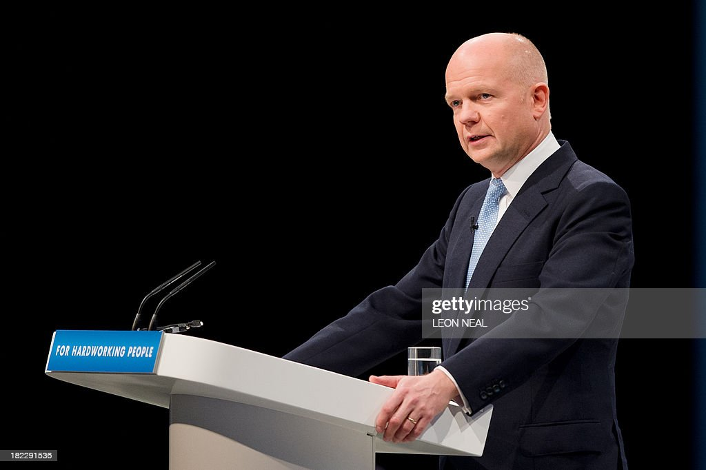 Foreign Secretary William Hague addresses delegates on the first day of the Conservative Party Conference in Manchester on September 29, 2013. British Prime Minister David Cameron said the austerity drive pursued by his government was 'beginning to pay off' after his Conservative party announced two potentially crowd-pleasing measures ahead of its annual conference.