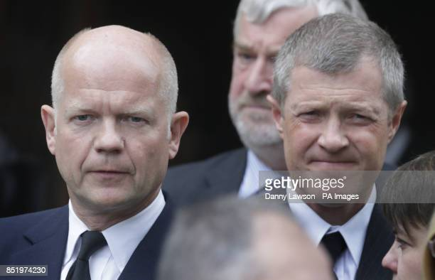 Foreign Secretary William Hague and Leader of the Scottish Liberal Democrats Willie Rennie right attend the funeral of former Scottish Tory leader...