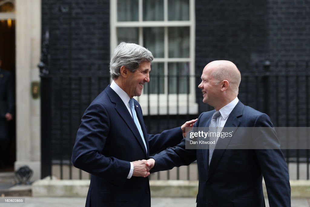 Foreign Secretary <a gi-track='captionPersonalityLinkClicked' href=/galleries/search?phrase=William+Hague&family=editorial&specificpeople=206295 ng-click='$event.stopPropagation()'>William Hague</a> (R) and US Secretary of State <a gi-track='captionPersonalityLinkClicked' href=/galleries/search?phrase=John+Kerry&family=editorial&specificpeople=154885 ng-click='$event.stopPropagation()'>John Kerry</a> shake hands as they leave 10 Downing Street on February 25, 2013 in London, England. Mr Kerry is on an 11-day tour, and is due to visit Berlin, Paris, Rome, Ankara, Cairo, Riyadh, Abu Dhabi and Doha.