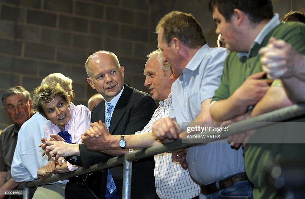 Foreign Secretary William Hague (4L) meets local farmers during a cattle auction at the Thirsk rural business centre in Thirsk, north Yorkshire, England on May 20, 2010, Hague was in the region to vist Conservative councillor Anne McIntosh who is standing in the Malton and Thirsk local elections.