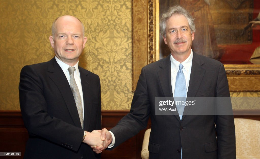 Foreign Secretary <a gi-track='captionPersonalityLinkClicked' href=/galleries/search?phrase=William+Hague&family=editorial&specificpeople=206295 ng-click='$event.stopPropagation()'>William Hague</a> (L) meets with US Under Secretary William Burns to discuss international action on the Libya crisis on February 26, 2011 in London, England. An estimate of more than 1,000 people have died in the ten-day-old revolt in Libya.