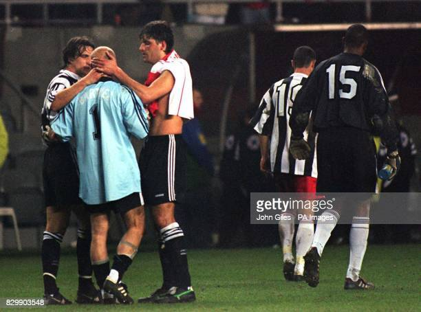Foreign stars David Ginola and Philippe Albert congratulate Monaco goalkeeper Fabien Barthez after he pulled off some fine saves to give Monaco...