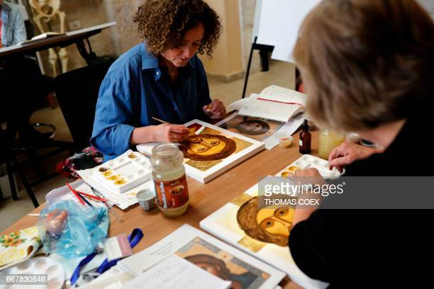 Foreign students of the Bethlehem Icon Center work on their painting during their course in the biblical West Bank city of Bethlehem on April 11 2017...