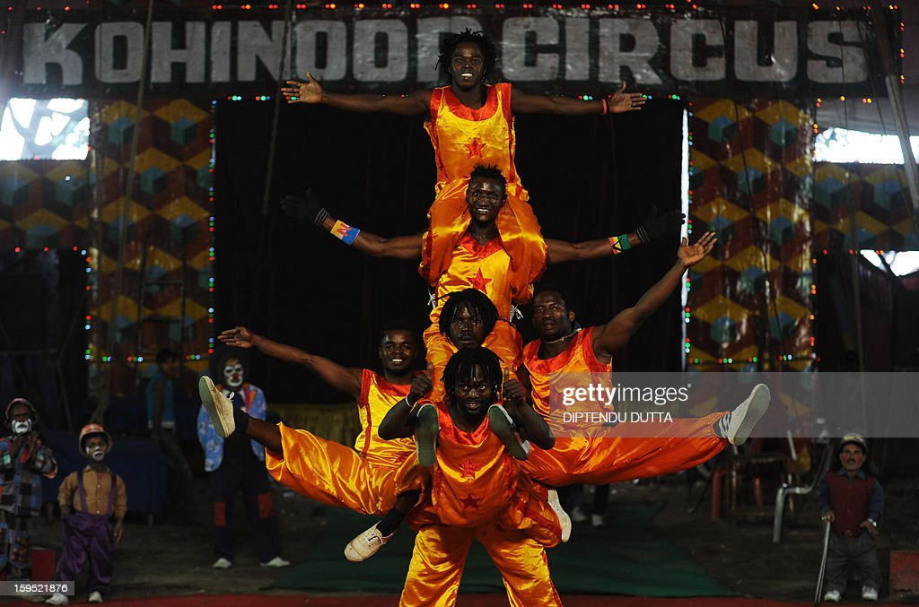Foreign stuntmen preform a balancing act during a show at the Kohinoor Circus in Siliguri on January 14, 2013. The Kohinoor Circus, inaugurated in 1988, is one of the most popular as it travels throughout India. At present, there are only ten circuses still active in India whereas in the first half of the 20th century, there were as many as 50 circuses touring the country. AFP PHOTO/ Diptendu DUTTA
