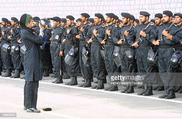 A foreign television camerawoman covers a police officers' gradation ceremony at Tehran's police academy 04 October 2003 Iran bestowed diplomas upon...