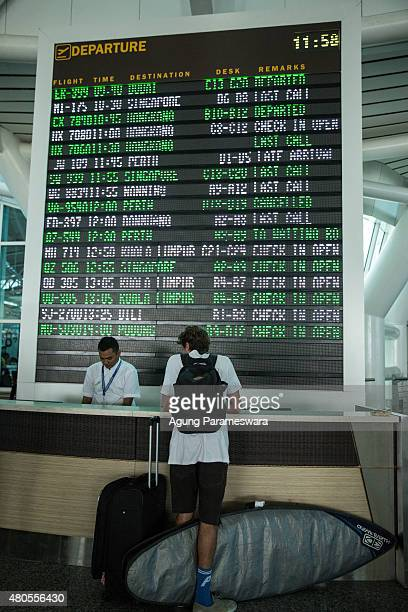A foreign tourist asks his flight informationn to the officer at Ngurah Rai International airport departure on July 13 2015 in Denpasar Bali...
