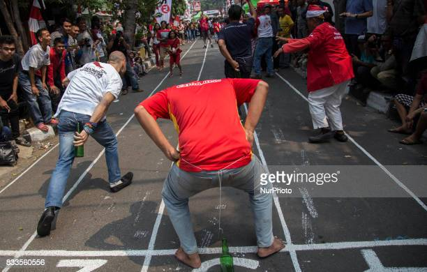 Foreign tourist having fun time during the Indonesia Independence day celebration at Jaksa Street Indonesia on August 17 2017 Jaksa street well known...