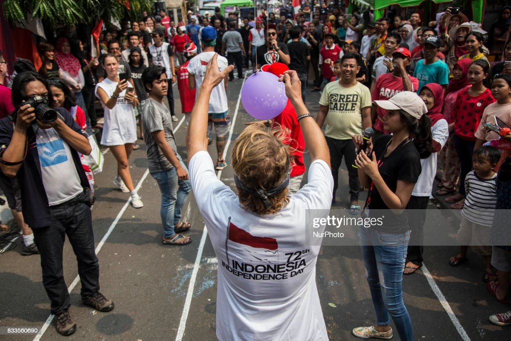 Foreign tourist having fun time during the Indonesia Independence day celebration at Jaksa Street, Indonesia, on August 17, 2017. Jaksa street well known for foreign tourist to stay because of it cheap price for staying and the friendly welcome from the neigbourhood.