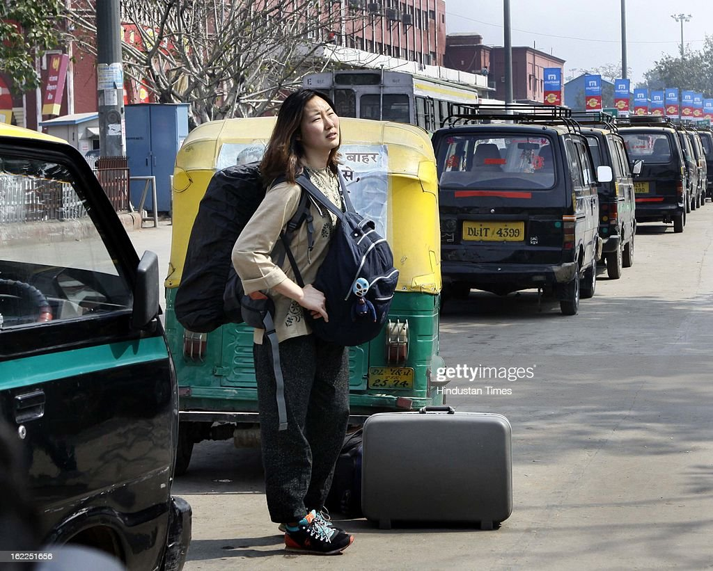 Foreign tourist not find any auto or taxi to reach Karol Bagh due to Call 'Bharat Bandh' was given by various Trade Unions at Old Delhi railway station on February 21, 2013 in New Delhi, India.