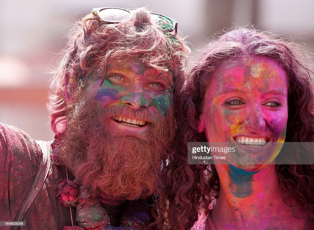 Foreign tourist playing with colors on the occasion of Holi festival celebrations at Durgiana Temple,on March 27, 2013 in Amritsar, India. Holi, festival of color is Hindu religious festival also called Basantotsav or spring festival as it mark the arrival of spring. People gather together to play colors, sing and dance to traditional tunes and eat sweets specially Gujiyas.
