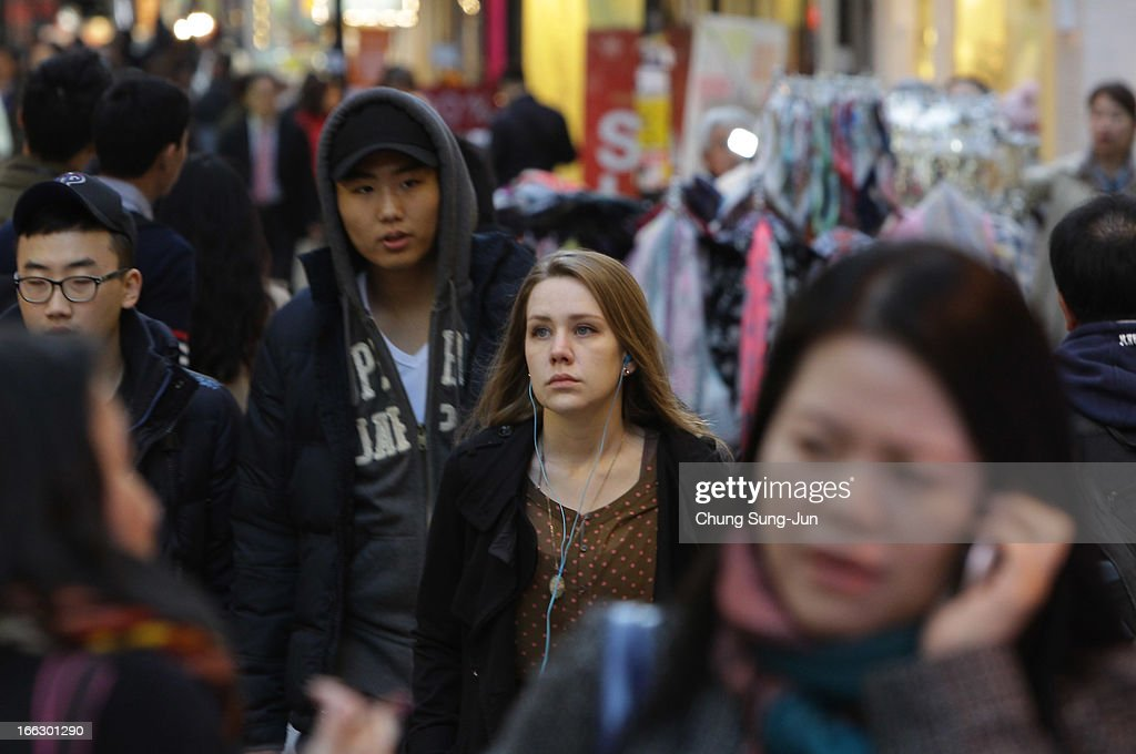 A foreign tourist walks in the Myungdong shopping district on April 11, 2013 in Seoul, South Korea. According to reports a North Korean missile launcher has been moved into firing position as the continuing threats of attack emit from Pyongyang. G8 leaders have convened in London to discuss the situation.
