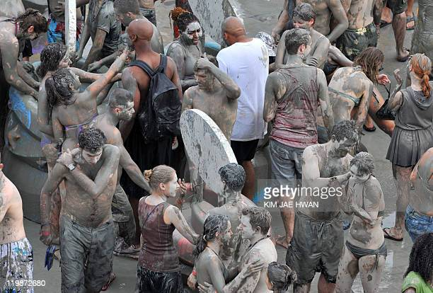 Foreign tourists and South Korean take part in the Boryeong Mud Festival in Boryeong 190 kilometers southwest of Seoul on July 16 2011 The annual...