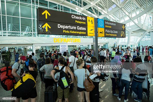 Foreign tourists arrive at Ngurah Rai International airport departure on July 13 2015 in Denpasar Bali Indonesia Bali's international airport...