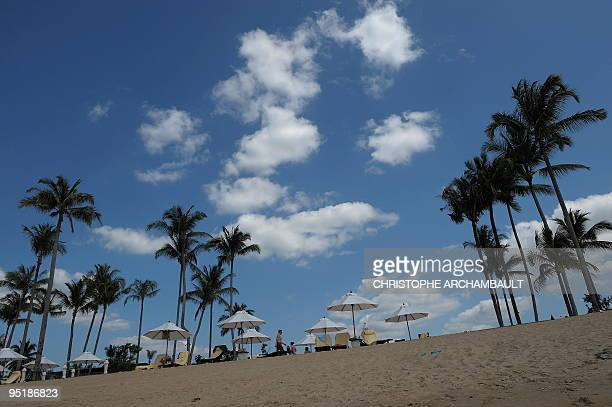 Foreign tourists enjoy a day at the beach at Khao Lak one of Thailand's worstaffected areas by the tsunami which struck the country's western Andaman...