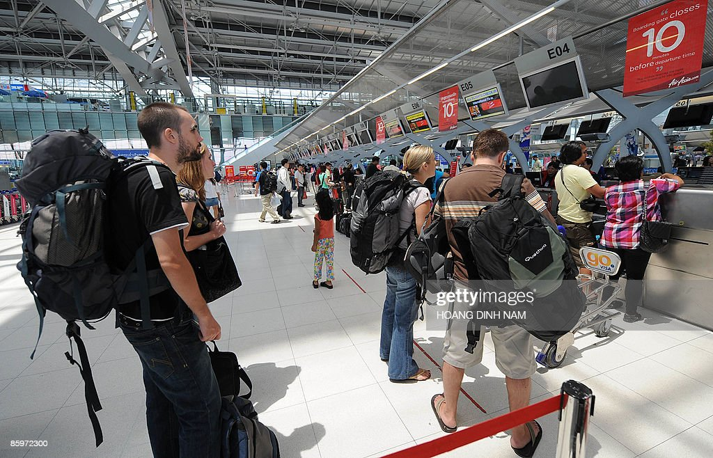 Foreign tourists line up for checkin on the departure hall of Bangkok's Suvarnabhumi airport on April 14 2009 Thailand's battered tourism sector...