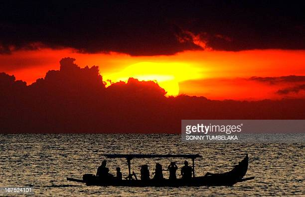Foreign tourists on a traditional boat enjoy the sunset at Kuta beach in Bali on April 26 2013 According to data from the Central Statistics Agency...