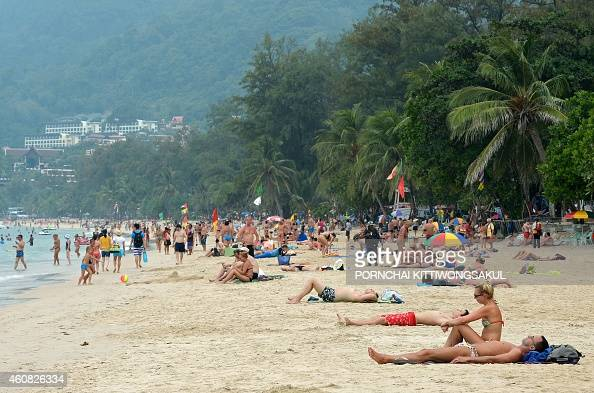 Foreign tourists relax at Patong beach in Phuket province on December 25 2014 In the morning of December 26 2004 a 93magnitude earthquake off...