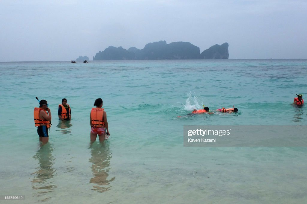 Foreign tourists snorkel in the water on Long Beach on October 20 in Koh Phi Phi Don, Thailand.