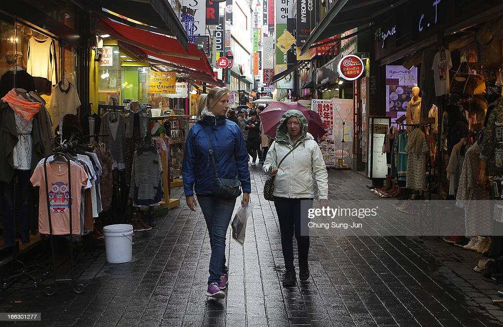 Foreign tourists walk in the Myungdong shopping district on April 11, 2013 in Seoul, South Korea. According to reports a North Korean missile launcher has been moved into firing position as the continuing threats of attack emit from Pyongyang. G8 leaders have convened in London to discuss the situation.