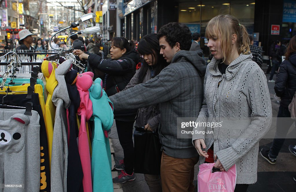 Foreign tourists walk in the Myungdong shopping district on April 11, 2013 in Seoul, South Korea. According to reports a North Korean missile launcher has been moved into firing position as the continuing threats of attack emit from Pyongyang. G8 leaders have convened in London to discuss the situation..