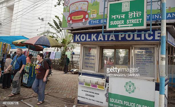 Foreign tourists walk past a police assistance booth on Sudder Street a popular tourist haunt and the area where a young Japanese tourist's ordeal as...