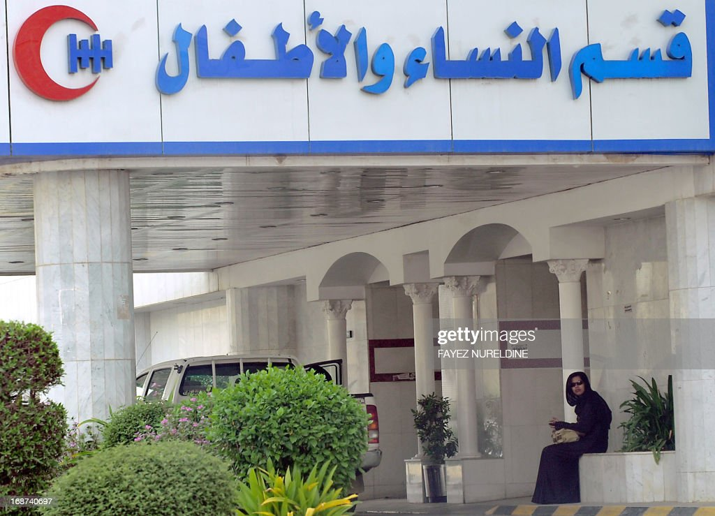 A foreign woman waits at the entrance of a hospital in the center of the capital Riyadh, on May 14, 2013. Four more cases of the deadly coronavirus have been detected in Saudi Arabia, the health ministry said, raising the number of people infected from the SARS-like virus in the kingdom to 28, including 15 fatalities.