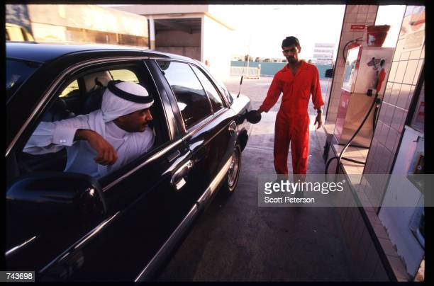 A foreign worker fills a car with the cheapest petroleum in the world July 15 1996 in Jubayl Saudi Arabia Possessing twentyfive percent of the...