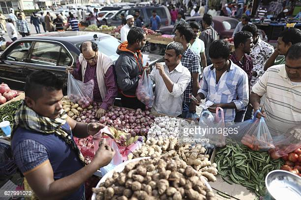 Foreign workers on a rest day shop for fresh food products from a market stall in Riyadh Saudi Arabia on Thursday Dec 1 2016 Saudi Arabia is working...