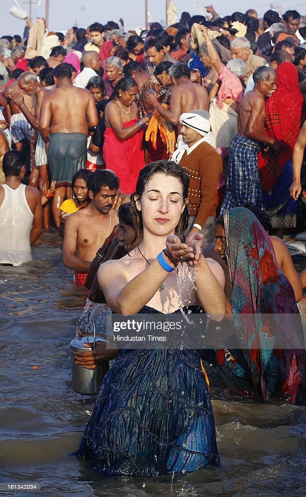 A foreigner devotee offering her prayer at the bank of Sangam confluence of river Ganga, Yamnuna and mythical Saraswati on the occasion of Mauni Amawasya on February 10, 2013 in Allahabad, India. Tens of millions of Hindus gathered Sunday for a holy bath in India's sacred river Ganges on the most auspicious day of the world's largest religious festival.