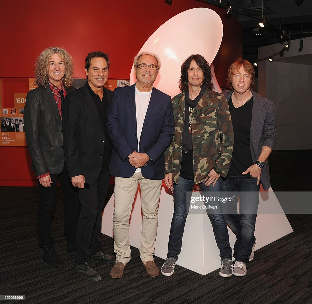 Foreigner members (L-R) Bruce Watson, Tom Gimbel, Mick Jones, Kelly Hansen and Jeff Pilson pose before Juke Box Heroes: An Evening With Foreigner at The GRAMMY Museum on October 30, 2012 in Los Angeles, California.