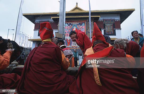 A foreigner receives a blessing from Pemagantse Monastery head lamas during the closing ceremony of the annual Bumchu Masked Dance Festival in Sikkim...