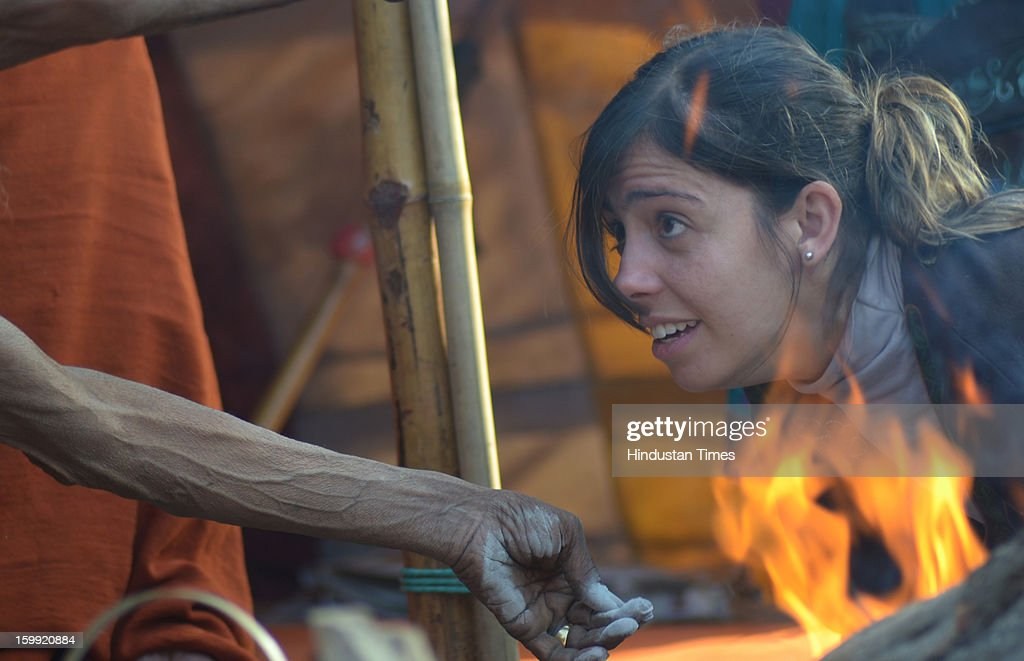 A foreigner taking blessing of a Sadhu in Juna Akada during Kumbh Mela, on January 23, 2013 in Allahabad, India. Kumbh is World's biggest religious gathering, in which more than 100 million of Hindus and sikh devotees will take part over 55 days. The second official Royal bathing (shahi Snan) is on Magh Purnima that falls on January 27, 2013.