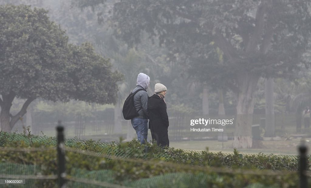 Foreigner Tourist cover themselves with woolens at Rajghat on January 6, 2013 in New Delhi, India. Setting a new low for temperature this winter, mercury in the national capital on Sunday fell to 1.9 degrees Celsius - five notches below average. This is the lowest recorded in Delhi in five years.