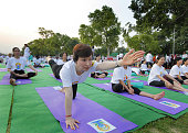 Foreigners and Diplomats participates in a mass yoga performance led by Prime Minister Narendra Modi to mark the International Day of Yoga at Rajpath...
