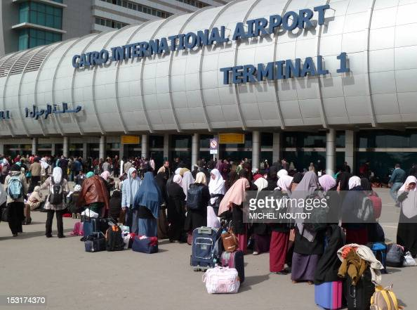 Foreigners crowd the entrance to Cairo's International Airport on February 3 2011 as many are leaving or being evacuated as Egyptians took to the...