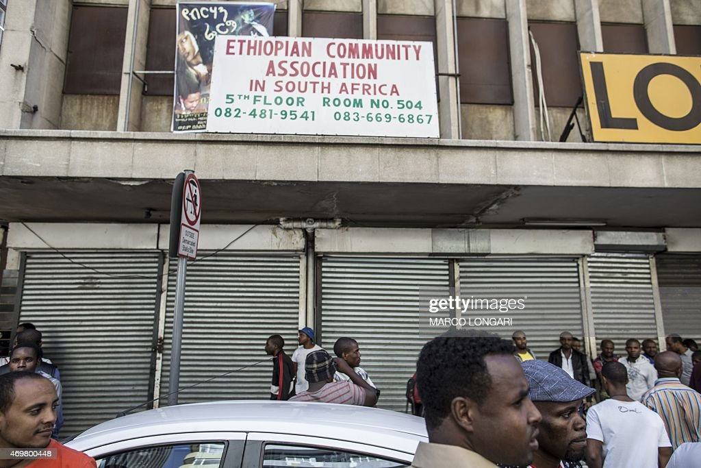Foreigners mostly Ethiopians stand in front of closed shops owned by foreign nationals in Johannesburg central business district on April 15 2015...
