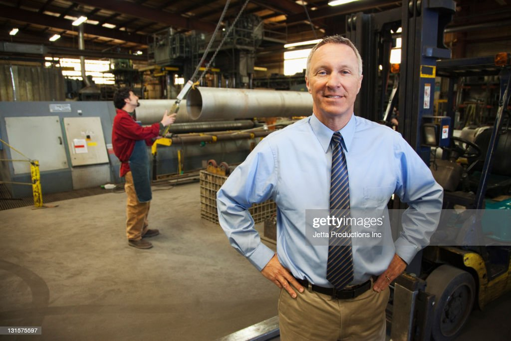 Foreman and worker in factory : Stock Photo