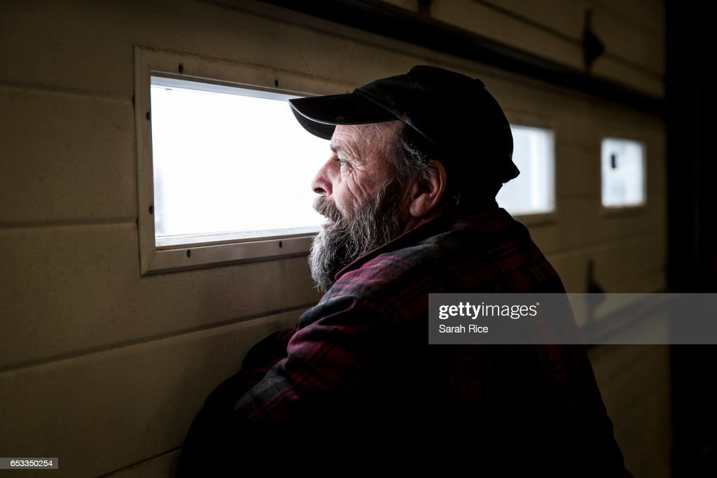 Foreman Keryn Annis keeps an eye on the snow falling from inside the garage at the Camden Public Works Highway Department yard on March 14, 2017 in Camden, Maine. Trucks were out first thing in the morning to combat the winter storm.