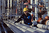 Foreman testing pipes
