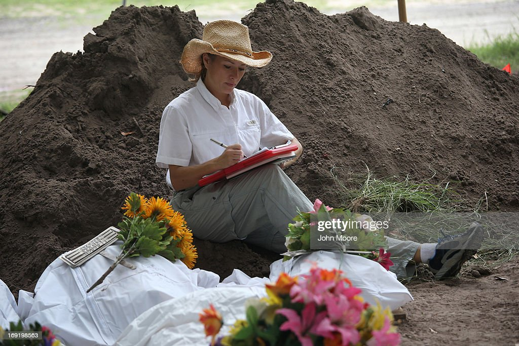 Forensic anthropologist Lori Baker from Baylor University logs data after her team exhumed the remains of unidentified immigrants from a cemetery on May 21, 2013 in Falfurrias, Texas. Teams from Baylor University and the University of Indianapolis are exhuming the bodies of more than 50 immigrants who died, mostly from heat exhaustion and dehydration, while crossing illegally from Mexico into the United States. The bodies will be examined and cross checked with DNA sent from Mexico and Central American countries, with the goal of reuniting the remains with families. In Brooks County alone, at least 129 immigrants perished in 2012, the highest rate in the United States, according to forensic anthropologists.